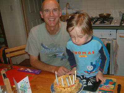 Helping daddy blow out birthday candles